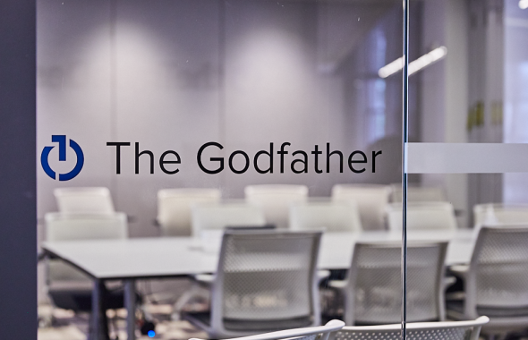 "A glass conference room door reads ""The Godfather"""
